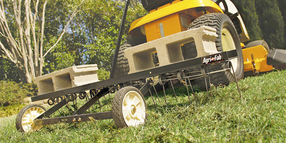 Dethatch compacted grass clippings